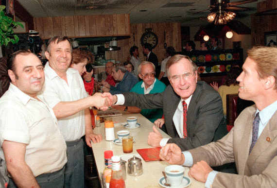 George H.W. Bush having coffee