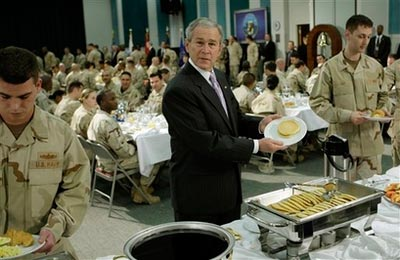 President George W. Bush showing off a pancake