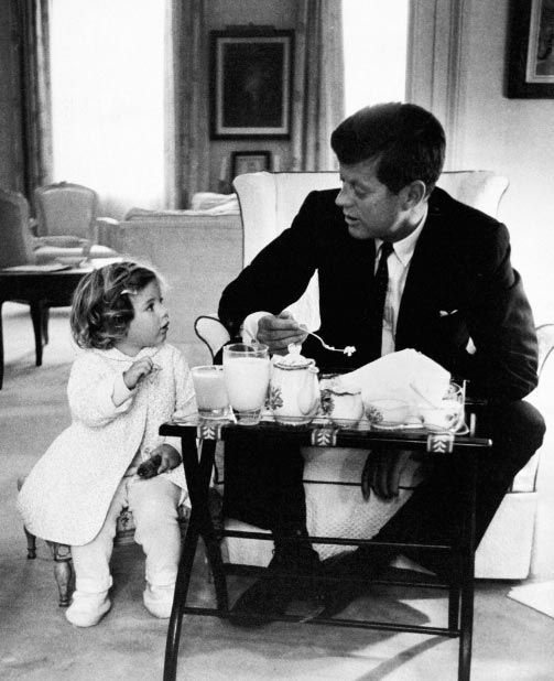 President John F. Kennedy Having Breakfast With Daughter