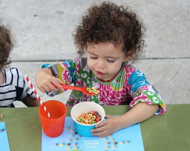 Cute Kid Eating Fruity Cheerios