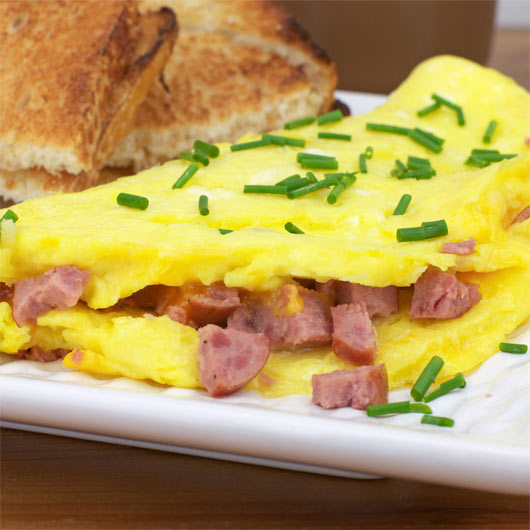 Summer Sausage Cheddar Omelette Garnished With Chives