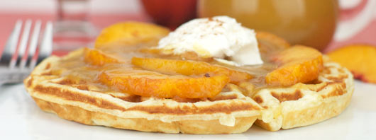 Peach Waffles with Peach Syrup And Whipped Cream