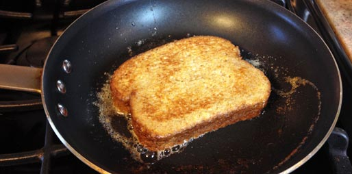 Frying Peanut Butter And Jelly French Toast