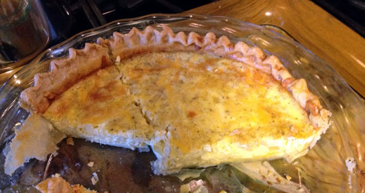 Partially Eaten Cheese And Onion Quiche