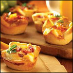 Baked Eggs and Sausages in Toast Cups