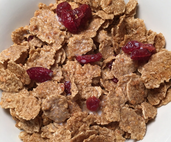A bowl of Quaker Cranberry Apple Multigrain Flakes Cereal